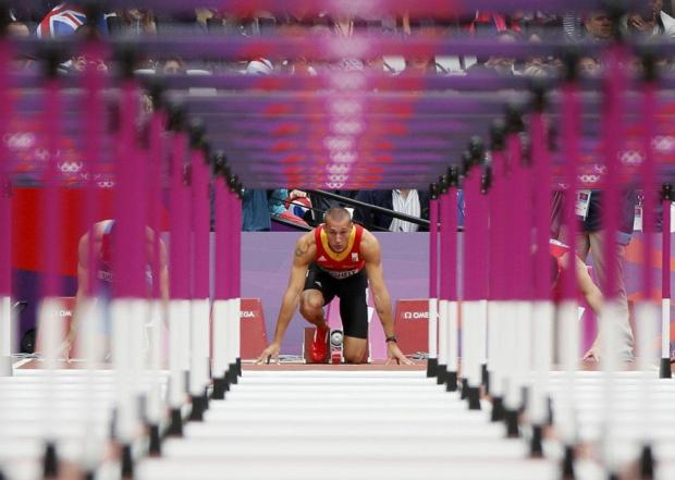 Belgium's Adrien Deghelt prepares to start his men's 110m hurdles round 1 heat at the London 2012 Olympic Games at the Olympic Stadium