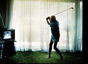 practicing golf swing by Larry Sultan